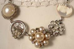 True Vintage Ivory Pearl, Rhinestone, and Cameo Bridal Bracelet, Heirloom Cluster Earring Silver Bracelet OOAK. $39.99, via Etsy.