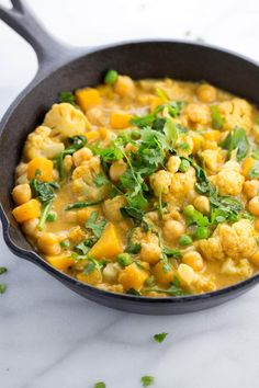 Chickpea Cauliflower Butternut Squash Curry - A vegetarian Indian recipe simmered in coconut milk with aromatic spices and served with basmati rice   jessicagavin.com
