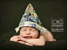 Tallahassee baby and family photographer, Linda Long of Long's Photography, creating newborn photos for those who love superheros!  Paper hat with superhero comics lend to this fun newborn image with baby boy