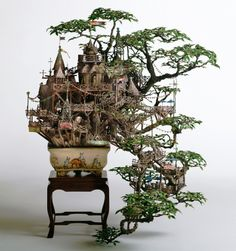 This is one of a series of extreme bonsai tree house creations. We assume this is a library, naturally.