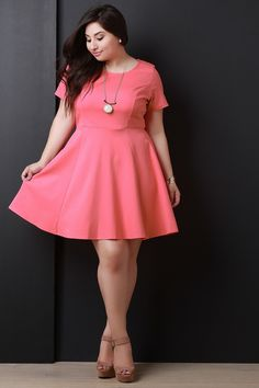 Coral Round Neck Short Sleeves Skater Dress - This plus size skater dress features a round neckline, stretchy thick knit fabrication, short sleeves design, and flare skirt.