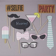 Fun pack of colourful chevron themed photo booth props, perfect to take memorable pictures with your guests!A pack of fun, colourful chevron themed photo booth props. Props include; #SELFIE, PARTY, pastel coloured ice lolly, cocktail, chevron design tie and bow tie, moustache and chalkboard speech mark all on sticks aswell as sunglasses and glasses. Brilliant for birthday parties, summer garden parties and BBQs, just about any celebration!Card and wood. Each prop is around 25cm high with the…