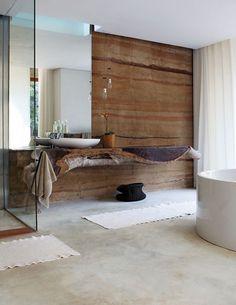 Amazing bathroom!! Slab stone wall, wood live edge shelf vanity, plate mirror