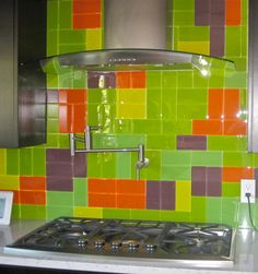 Bright color blocked kitchen backsplash using 5 colors of our  Lush 3x6 glass subway tile. www.modwalls.com