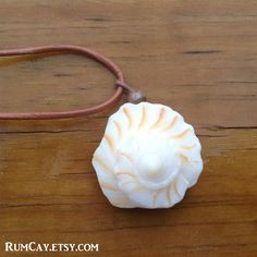 """Tip of a Lightning Whelk Seashell on brown leather Necklace  by Rum Cay Island Jewelry 10% off with coupon code """"pinterest"""""""