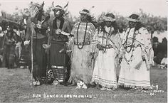 (Can you imagine dancing it what our grandmas danced in?) Five unidentified Sioux Indians, two men and three women, wear ceremonial sun dance clothing .1899
