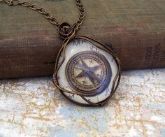 Compass Necklace of wire wrapped glass to by ElainaLouiseStudios, $29.00