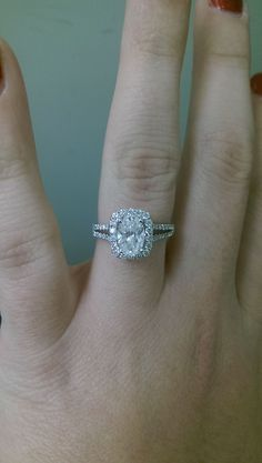 white gold, split shank, oval diamond with a rectangle halo engagement ring