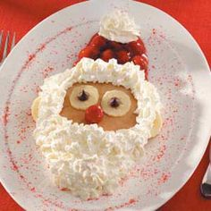 Santa Pancakes!  Perfect for the holiday season.  Use bananas for ears (halves) and eyes with chocolate chips.  Cherry pie filling for hat and nose.  Top with spray whipped cream for beard, hair and pom pom hat.  The kids will love it!