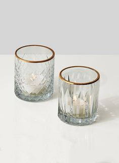 A pretty pattern of squares and double arrows are etched onto the outside of these glass votive holders, which gives them the elegant, timeless look of crystal. A painted gold rim adds another layer of glamor to these wholesale glass candleholders. Perfume Diesel, Glass Tea Light Holders, Glass Votive Holders, Wholesale Candle Holders, Bulk Candles, Votive Candles, Votive Centerpieces, Scented Candles, Wedding