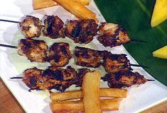 Bob Marley's Reggae: Jerk Marinated Chicken Breast Skewers, Chargrilled and Served with Creamy Cucumber Dipping Sauce and Yucca Fries from FoodNetwork.com