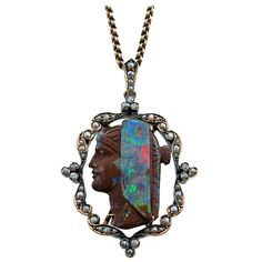 Boulder opal, diamond, silver and gold Egyptian revival pendant. Egypt Jewelry, Ancient Jewelry, Edwardian Jewelry, Antique Jewelry, Moonstone Jewelry, Drop Necklace, Jewelry Design, Fashion Jewelry, Jewels