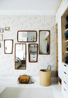 Decorate your wall with mirrors in teak.