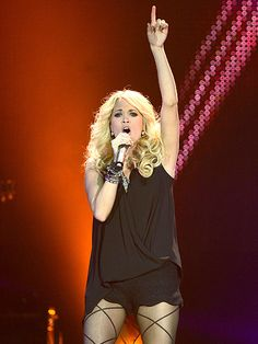 Carrie Underwood belts out a tune while performing at the C2C: Country to Country music festival in London. http://www.people.com/people/gallery/0,,20682576,00.html#21295637