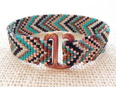 Lovely chevron, subdued colors. Also handmade with tutorial available at thefusionbeads site.