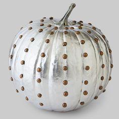 Metallic paint and furniture tacks make this no-carve pumpkin shine!