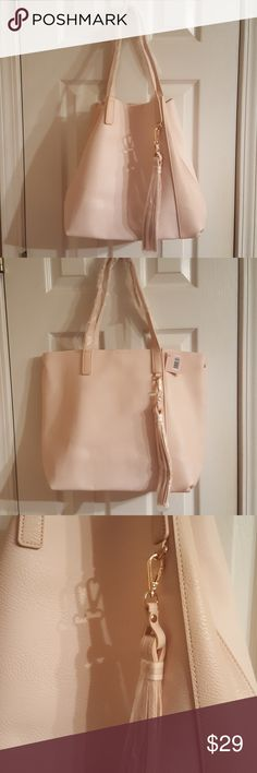 """NWT Pink Convertible Tote to Bucket Bag Brand New with Tags, never used, faux Pink Leather Tote can be converted to Bucket Bag with just a snap! Very Roomy!  Measurements: Straps: 10"""" hang Bag: 17.5"""" across x 13.5"""" tall x 6"""" depth. Tassel is removable:  9"""" ulta Bags Totes"""