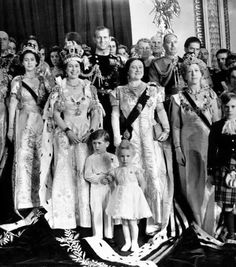 Newly inaugrated Queen Elizabeth II (Centre Left ) with her mother Queen Elizabeth (R) , sister Princess Margaret ( extreme left ) and husband Prince Philip (behind )