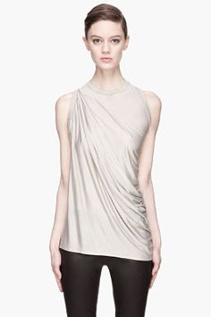 Overlong semi-sheer crewneck t-shirt in pearl grey. Gathered cross-body draping detail at shoulder. Tonal stitching. 100% silk. Hand wash. Made in Italy. 534 euro
