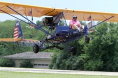 Arnie Zimmerman (cq), 74, takes off in his homemade Breezy experimental aircraft. (Chuck Berman/ Chicago Tribune)