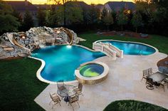 Pool slides and a bridge over the pool!!