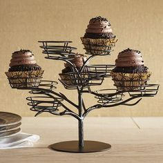 This Halloween, serve up your party snacks with a side of ghoulish whimsy. Our wrought-iron cupcake stand will do just the trick—serving your sweet treats inside 12 powder-coated nests perched on tree limbs.