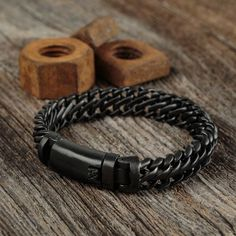Style up your wardrobe with this trendy matte black bracelet