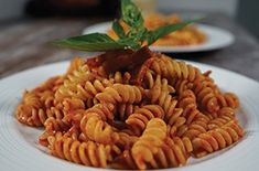 Pancetta Pasta forms the perfect pairing to smother and colour the pasta spirals. Pancetta Pasta Fusilli with Italian Bacon and Tomato Basil Sauce Tomato Basil Sauce, Italian Pasta Recipes, Fusilli, Bacon, Plates, Homemade, Dishes, Spirals