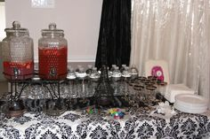 Parisian Themed Bridal Shower Drink Station  Canisters: Pink Lemonade, & Mango Cranberry Punch  Water Bottles with themed labels and mustache cut outs  Glass' - Party Goblets with individual colored suction tags so guests can identify their cups