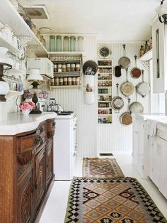Kitchen Interior A Laurel Canyon Cottage Home with a Hollywood Past : Architectural Digest *Spice rack with mason jars on top.* - Tour the lovely Laurel Canyon residence of an award-winning Hollywood costume designer Decor, Retro Home Decor, Kitchen Inspirations, Vintage Kitchen, Kitchen Decor, Cottage Kitchen, House Interior, Sweet Home, Home Kitchens