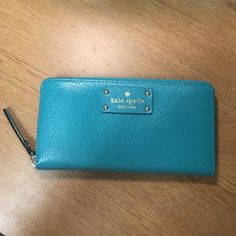 NWT Kate Spade wallet Brand new with tags turquoise blue Kate spade wallet. 12 card slots, pocket on back, coin pouch and 5 flaps inside for cash/receipts. No damage, perfect new condition! No trades but feel free to make me an offer! Got it for 158 but retails for more kate spade Bags Wallets