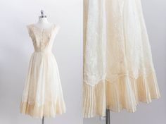 kind of fell in love with this last night.     1950s Cream Eyelet Lace Wedding Dress by EmmelineChic, $419.00