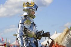 A modern re-enactor portraying Richard III. He is dressed in metal-plate armour of a type common in the late 15th century.