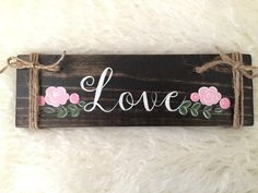 Hand painted wood sign with pink flowers. This sign is stained in dark walnut with hand painted white lettering. The material is made from pine,