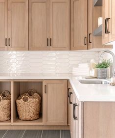 Home Decor Styles                                       Homeowners love the look of wood, and natural cabinets are back in a big way   Designed by Remedy Furniture & Design   #laundryroom #laundryroomdesign #laundryroomdecor #mudroo