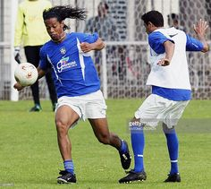 Brazilian soccer star Ronaldinho Gaucho (L) of French team Paris Saint Germain disputes the ball with teammate Marinho, 15 June 2003, during the morning training session at Camp des Loges trainning camp, 40Km from Paris, France, preparing to dispute the Confederation Cup starting next 18 June in France. Brazil faces Cameroom on 19th June, his first match in this tournament. AFP PHOTO Antonio SCORZA