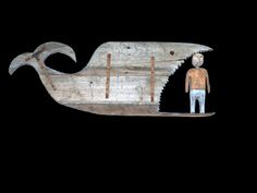 """hand carved wall mount whale created from salvaged siding from our old Va. Farmhouse. A hand carved Jonah stands in the Whale's mouth. L 32"""" H 12"""" D 5"""" $450"""
