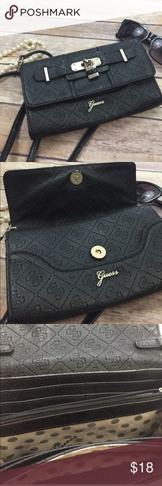 Guess purse Black guess purse. You can wear it over the shoulder or across the chest. Has a small lock decoration on the front. In good condition. Dimensions are 8 inches across and 4 1/2 inches height.   Keywords; little black purse, club purse, small purse, guess purse, across the chest, shoulder purse, designer purse Guess Bags Shoulder Bags