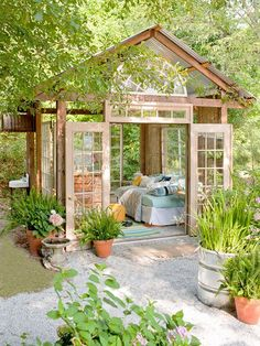 This garden retreat, or she shed, is a fun and relaxing addition to your backyard. Check out our plans for this she shed that includes a very open structure so you can enjoy the natural beauty of your garden. This particular shed uses antique windows and doors for a fun vintage touch.