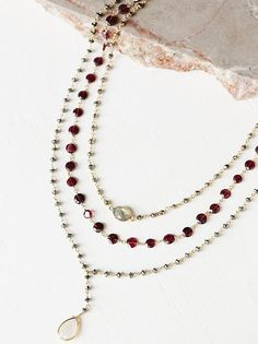 Three in One Layered Rosary | Gorgeous multi-tier lariat style necklace features semi-precious stone detailing. Each chain strand features a different color stone. Adjustable lobster clasp closure. American made.