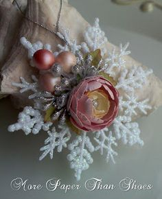 """You can find the snowflakes at any craft store. Last year I found some at the Dollar Tree that worked just as good too! These snowflakes can be decorated in so many ways. You don't have to just add flowers. Other ideas would be to make small medallions and glue them in the middle...maybe with a saying """"Merry Christmas"""", """"New Year"""", """"Joy"""" and the list goes on! Add some smaller snowflakes and build the snowflake up to have a lot of dimension. You could also add a small bow to the center of…"""