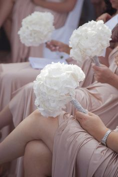 Glamorous Bridesmaid Bouquets -- I like the beading on the stems. MAYBE ADD A pop of pink and some black feathers in them