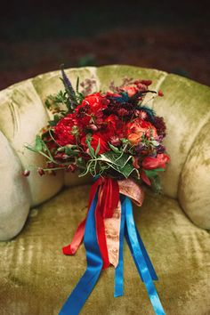 Loving the bold, red flowers in this ribbon-tied bouquet | @veronicavaros | Brides.com