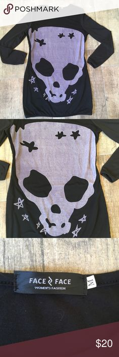 Starry skull Black Tunic Perfect for Halloween! A black Tunic with a grayish purple skull and stars. Gathers at the hem, pairs great with leggings. In excellent condition with no fading or holes. Approximate measurements: 20 inches armpit to armpit and 32 inches in length. Face to Face Tops Tunics