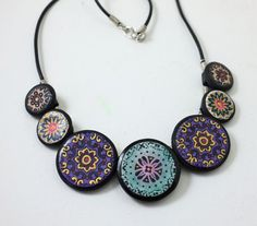 Circles and Prints Stamped Polymer Clay Necklace by RockyBeads
