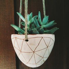 Hand Carved Ceramic Hanging Planter / Terracotta & White Stoneware Hanging Pot with Geometric Design / Succulent, Cactus, Herb, or Air Plant by HalfLightHoney on Etsy https://www.etsy.com/listing/209035890/hand-carved-ceramic-hanging-planter