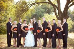 loving the black dress while still incorporating the wedding colors in the flowers :)