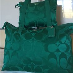 "Coach Signature Nylon Weekender Tote •$130 FREE SHIPPING •Payment plans available •NO HOLDS. NO TRADES. •SAME DAY -OR- NEXT DAY SHIPPING •Smoke/pet free home •Color: Jade green •In excellent used condition. No flaws. •Approximately 18""(L) x 12""(H) x 9"" at its widest point when completely full •Strap drop: Approximately 12"" •Makeup case: Approximately 9""(L) x 7""(H) Coach Bags Travel Bags"