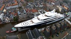 Typical Dutch ...Biggest yacht ever made in Holland, on its way to Rotterdam...