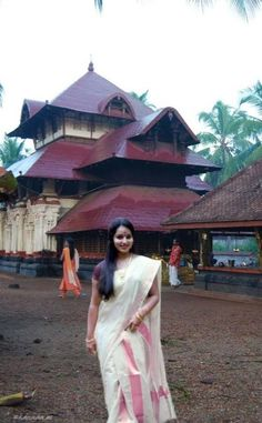 Kerala Traditional Hindu Saree   set against the incomporable beauty of an ancient Kerala temple